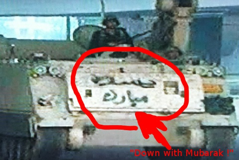"""Down with Mubarak"" (graffiti on tank)"