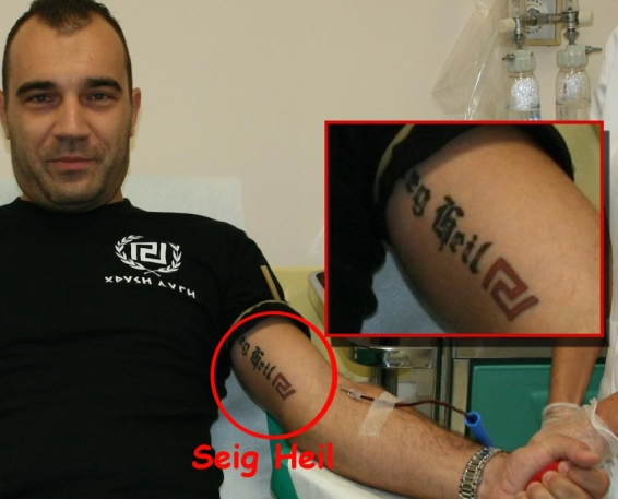 SEIG HEIL nazi tattoo of Golden Dawn Parliament- member Panagiotis Heliopoulos